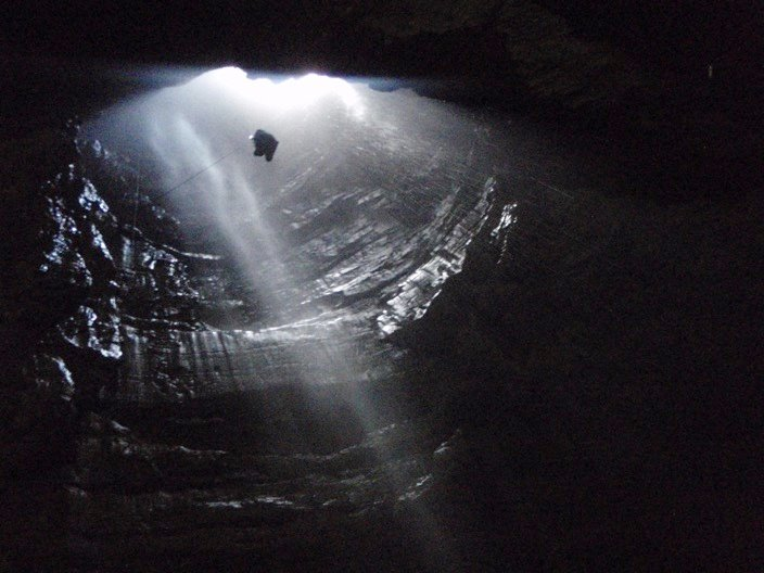 Going down – winching into Gaping Gill